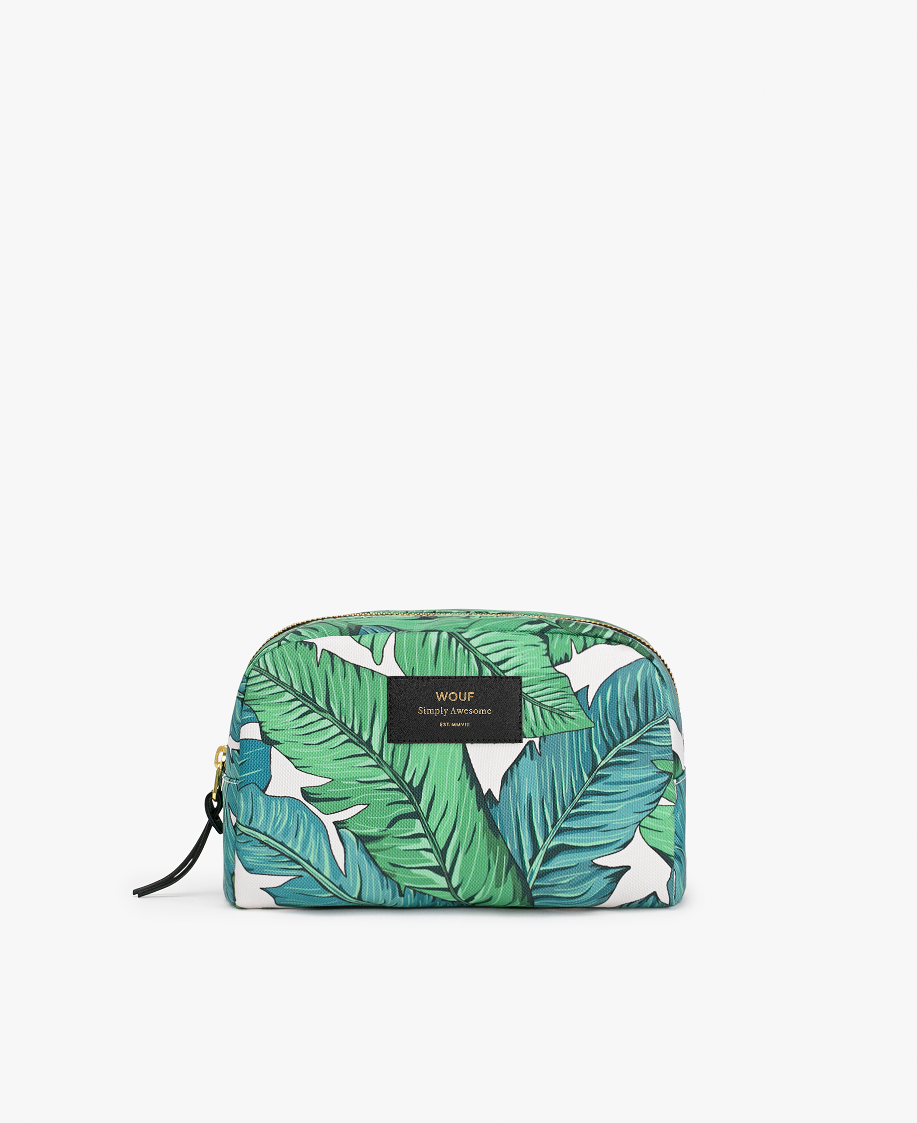 woman's toiletry bag in white with green leaves and golden zipper