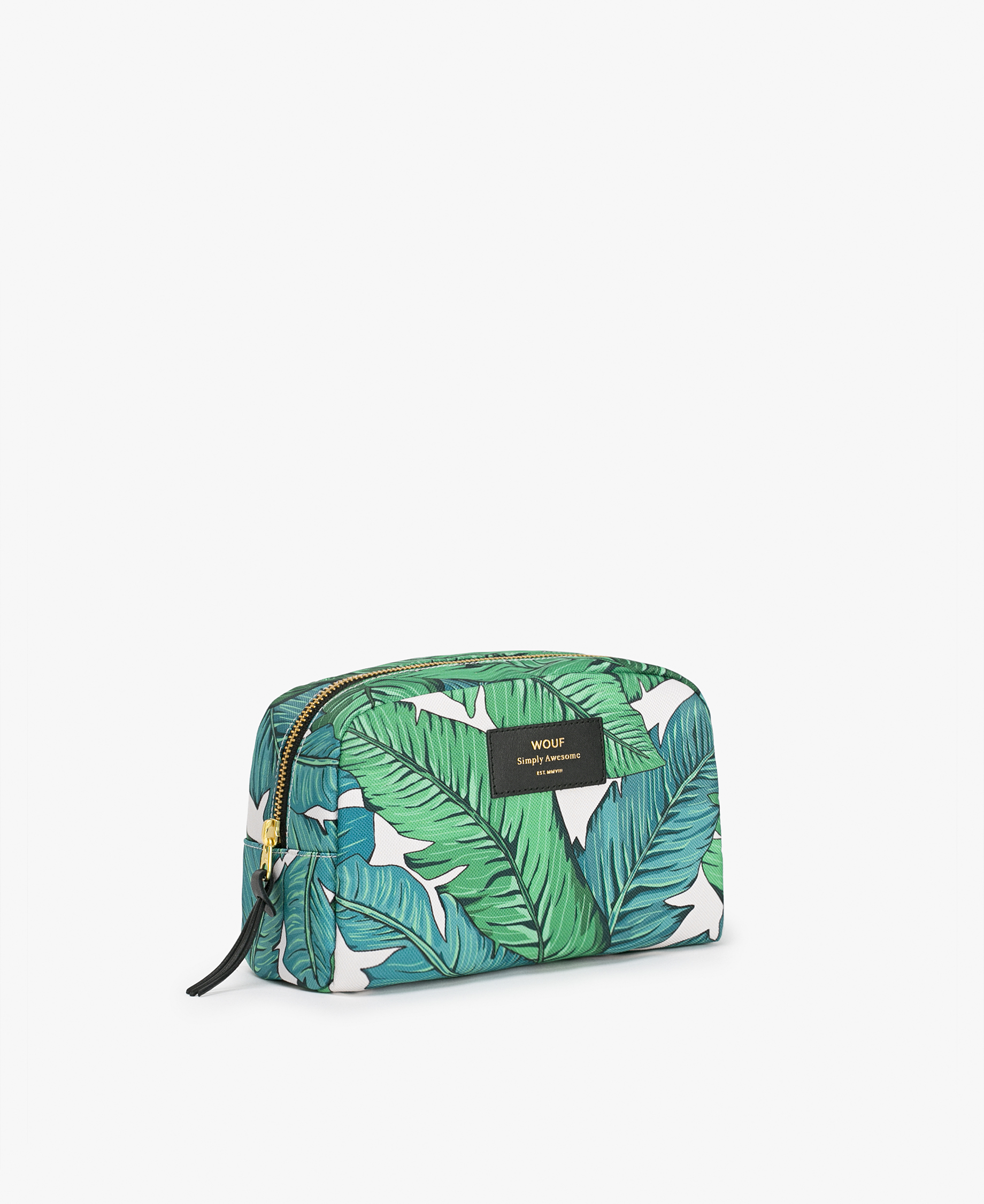 woman's toiletry bag in white with green leaves
