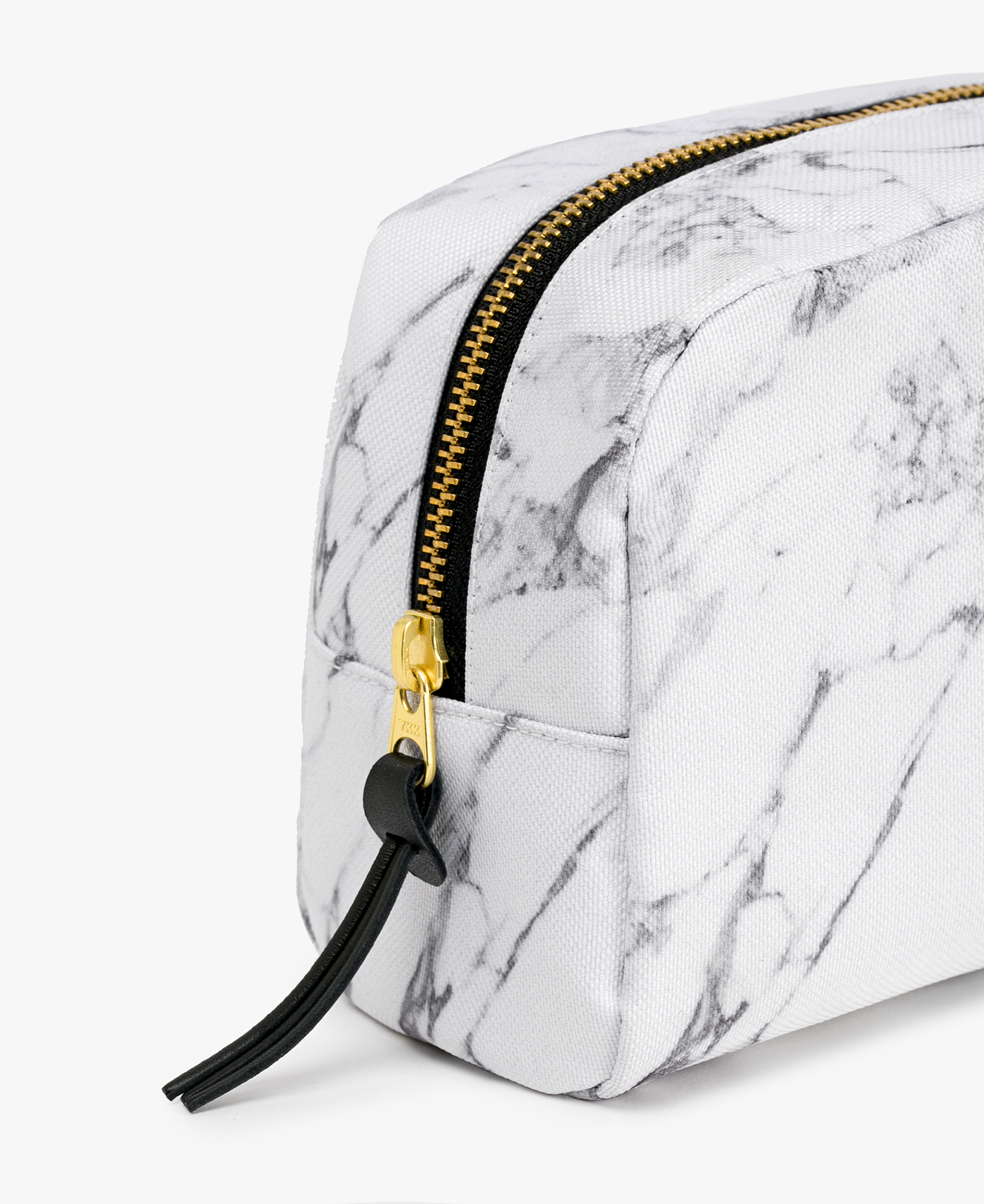 woman's toiletry bag in white with golden zipper