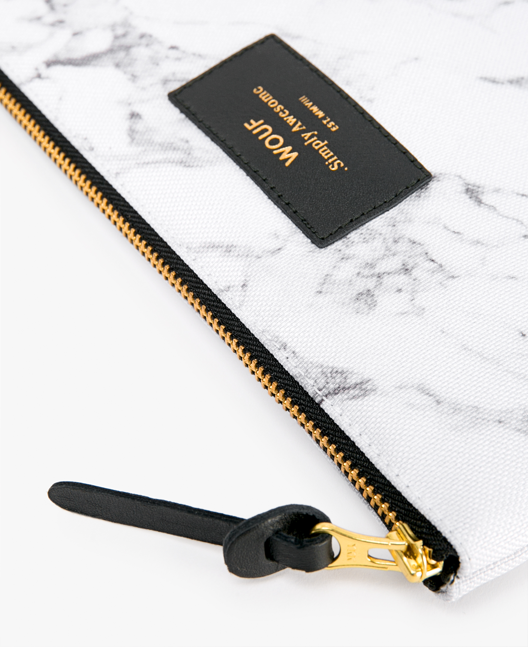 woman's large white pouch with golden zipper