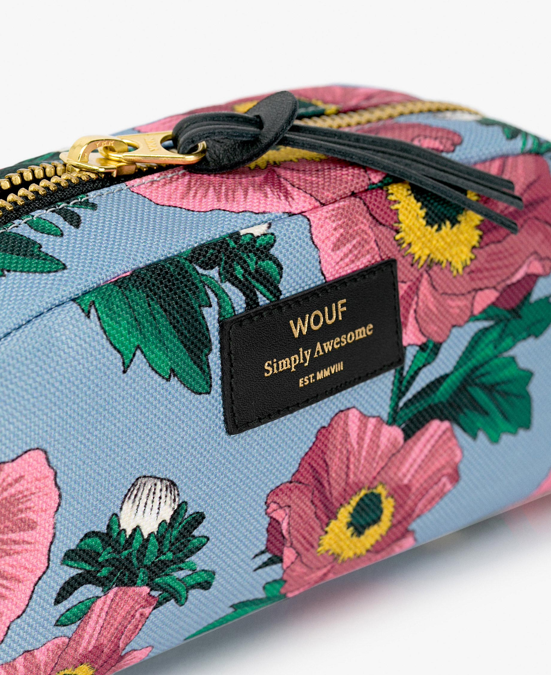 blue toiletry bag with flowers