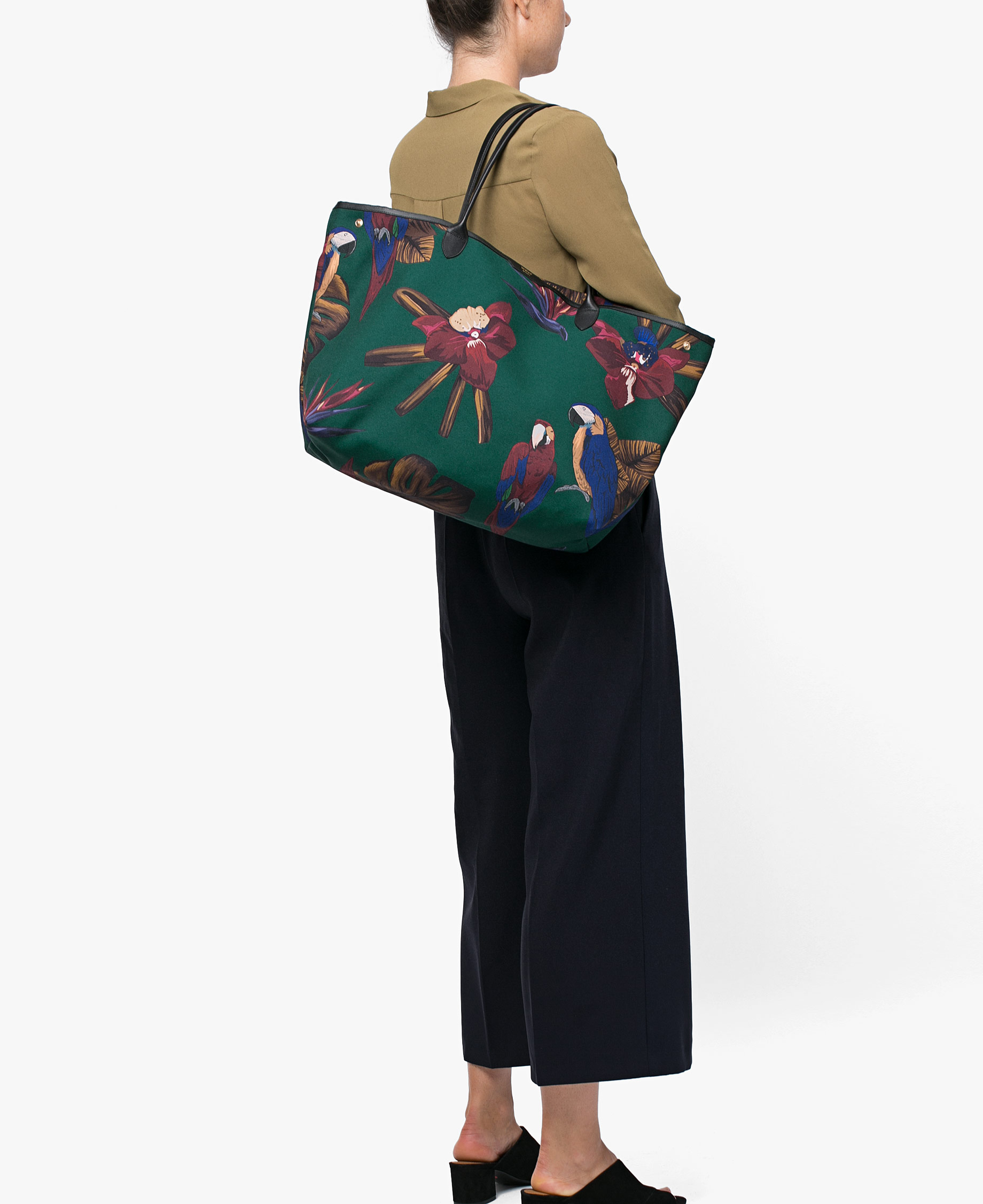 A woman with a big green bag