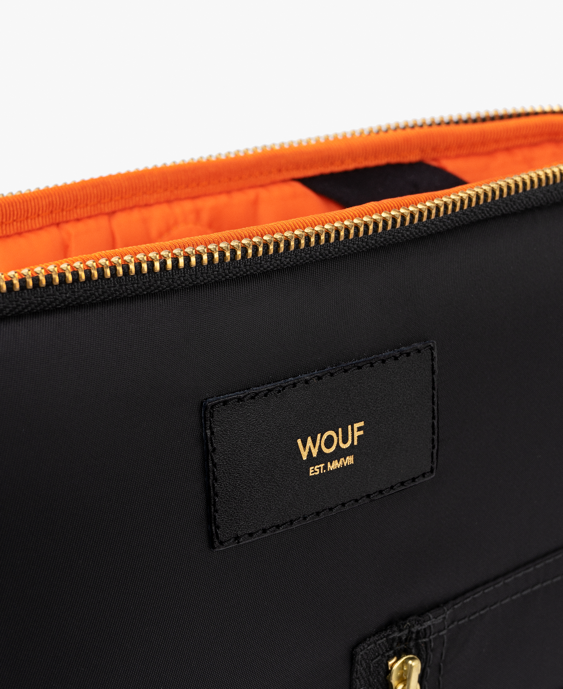laptop case with an orange compartment
