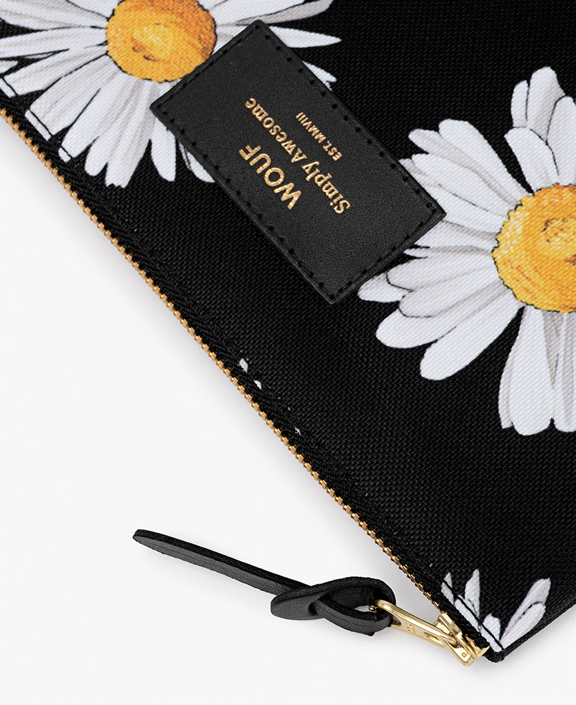 woman pouch in black with white flowers
