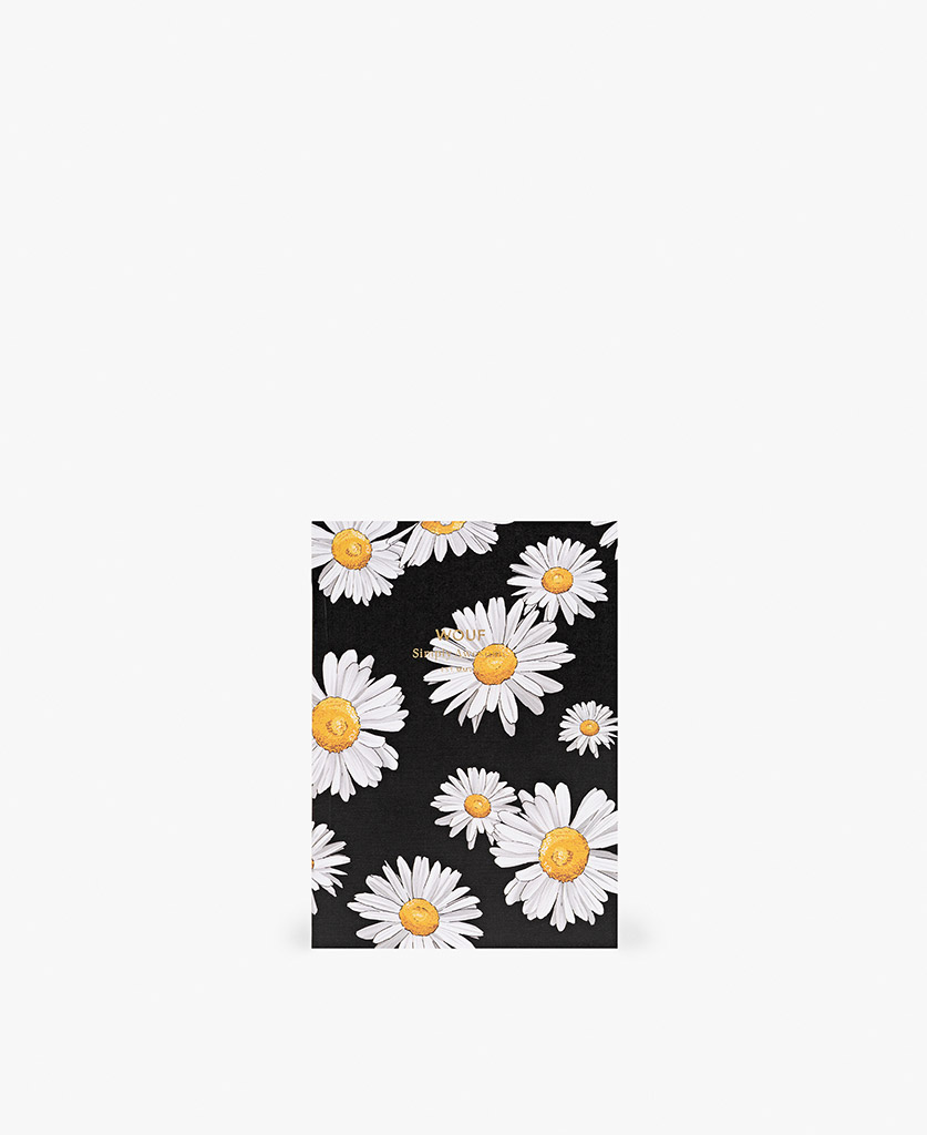 woman's A6 journal notebook in black with white flowers