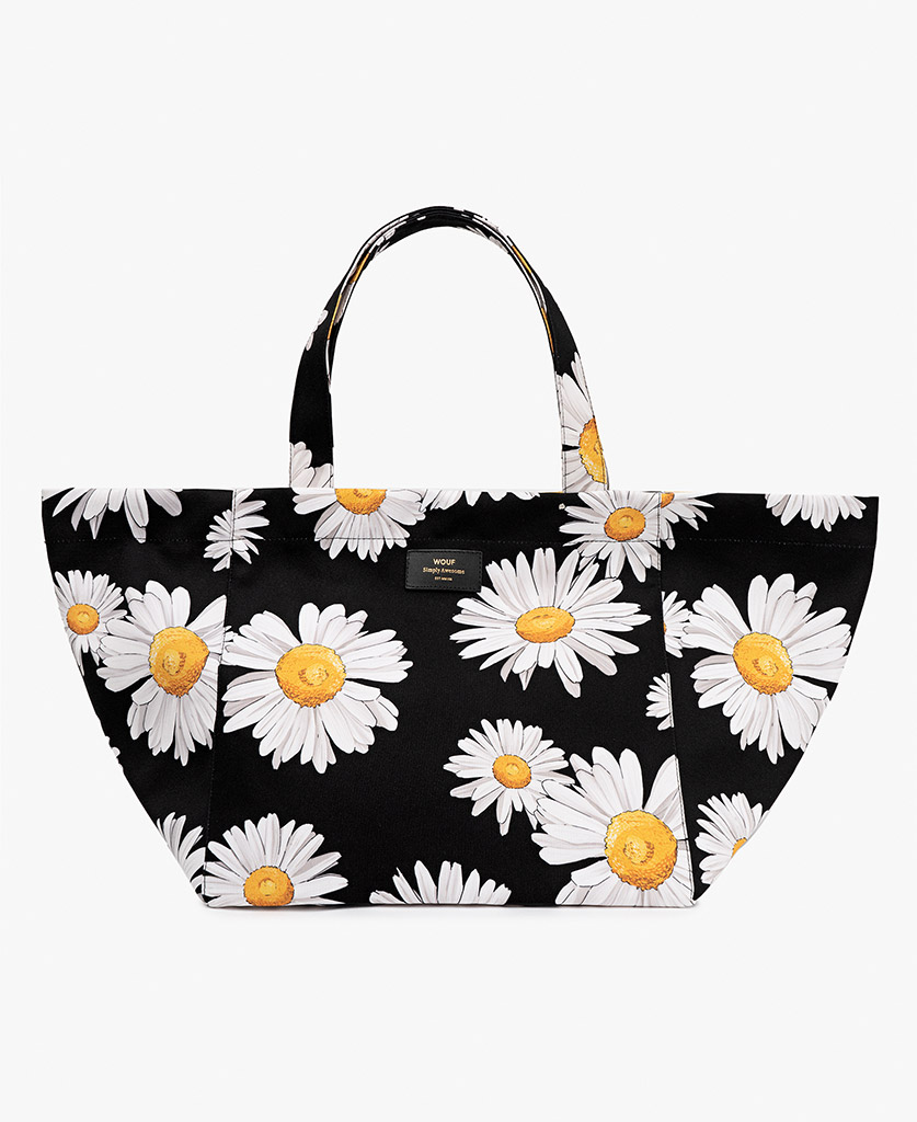 woman's black big bag with white flowers