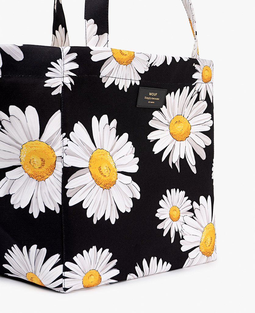 woman's black big bag with flowers