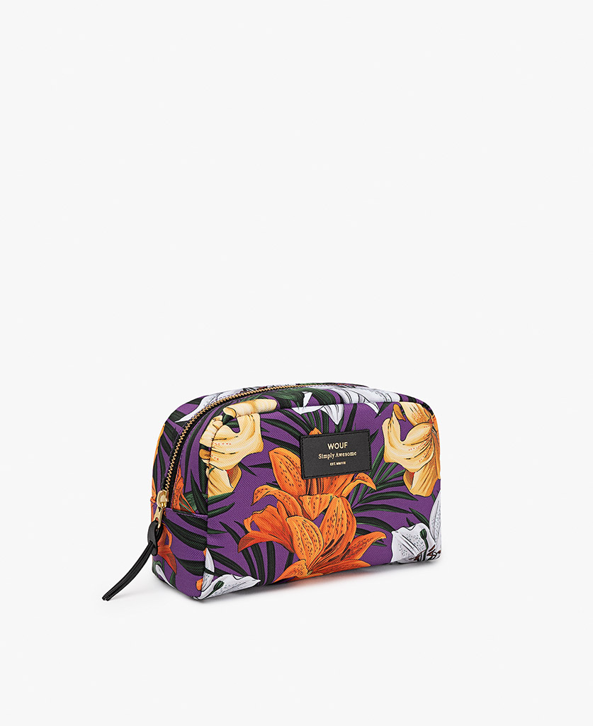 woman's toiletry bag in purple with orange flowers