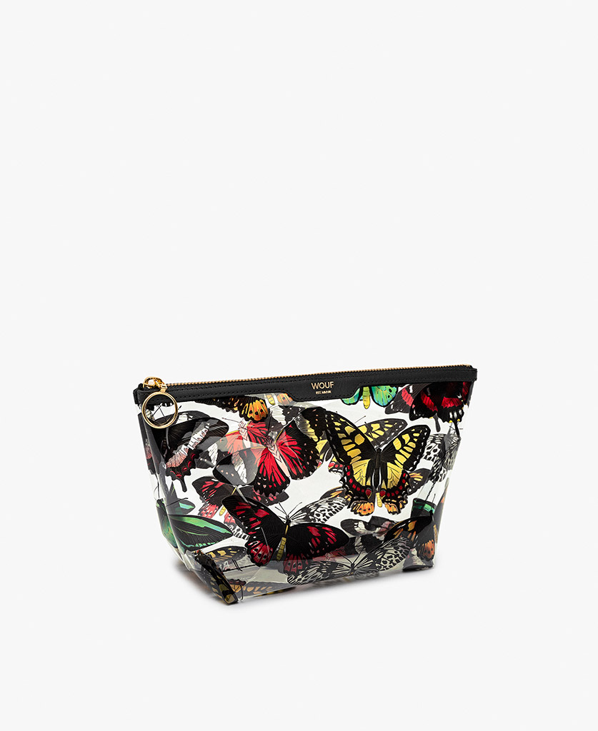 woman's vinyl toiletry bag with colorful butterflies
