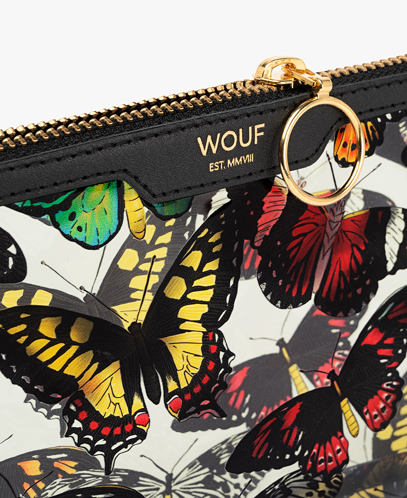 woman's vinyl clutch with butterflies
