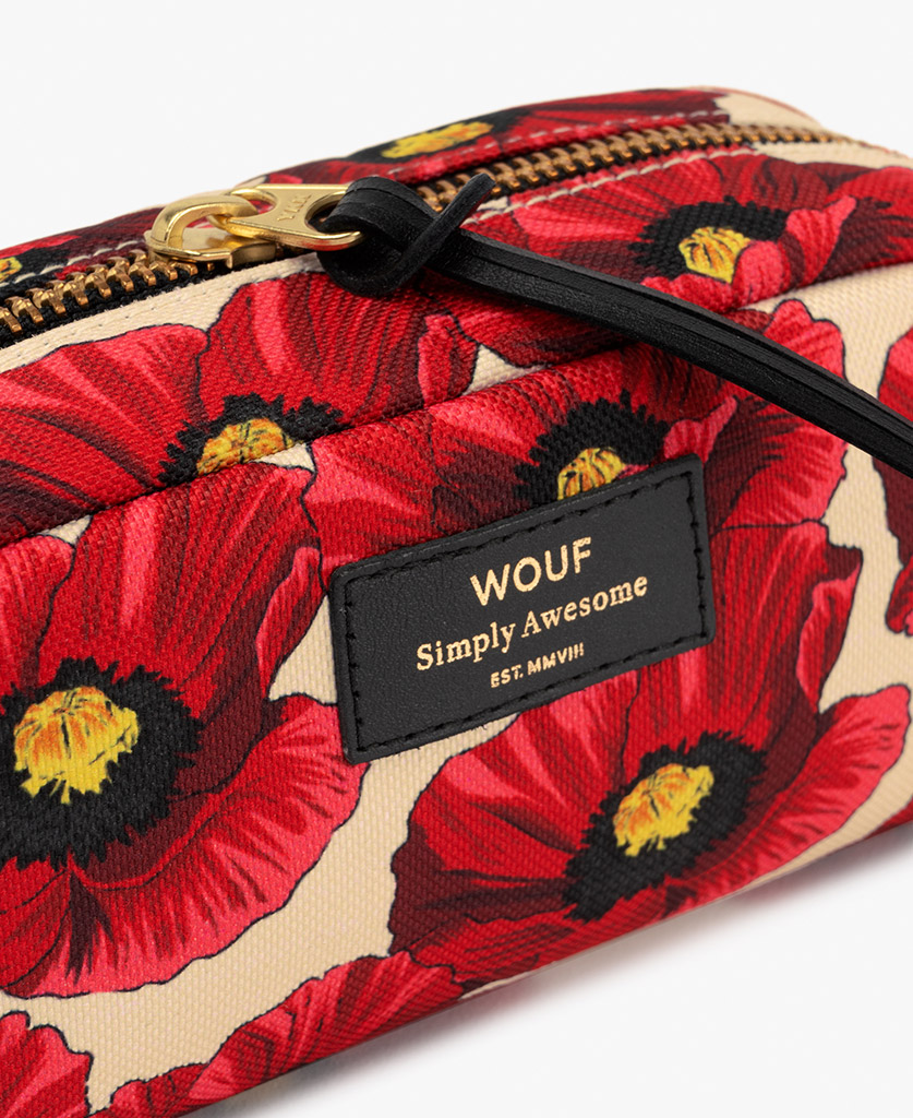 woman's toiletry bag in beige with leather label