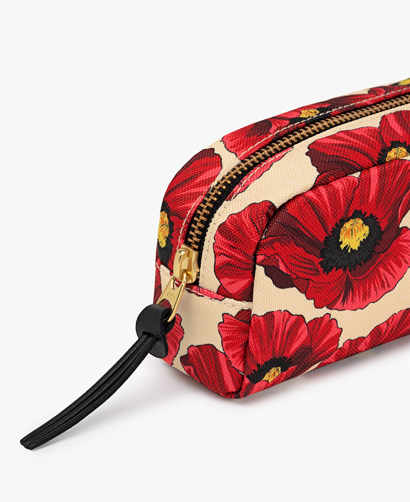 woman's toiletry bag in beige with red flowers
