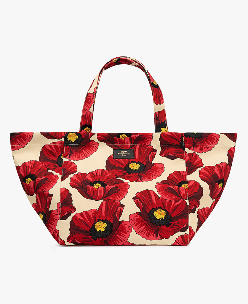 woman's beige tote bag with red flowers