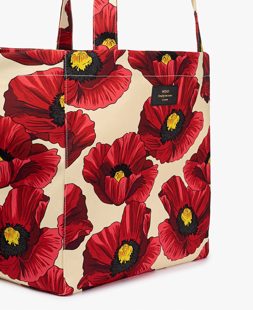 woman's beige big bag with red flowers