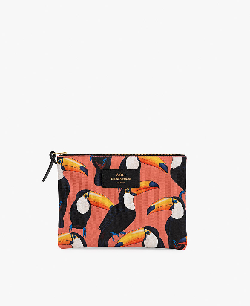 woman pouch bag in coral with toucans