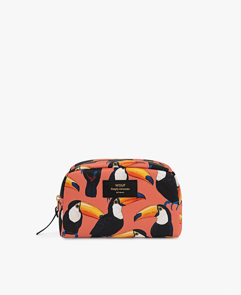 woman's coral toiletry bag