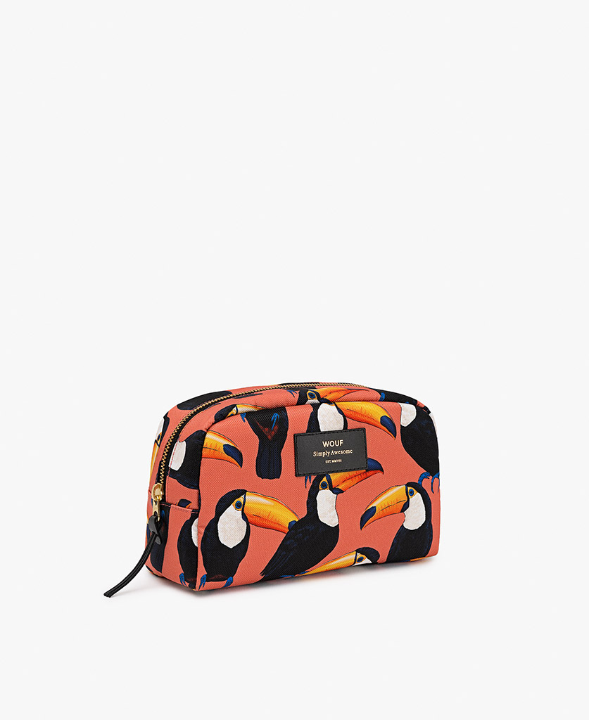 woman's toiletry bag in coral with birds
