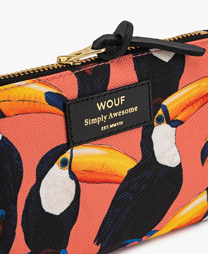 woman's pouch bag with birds
