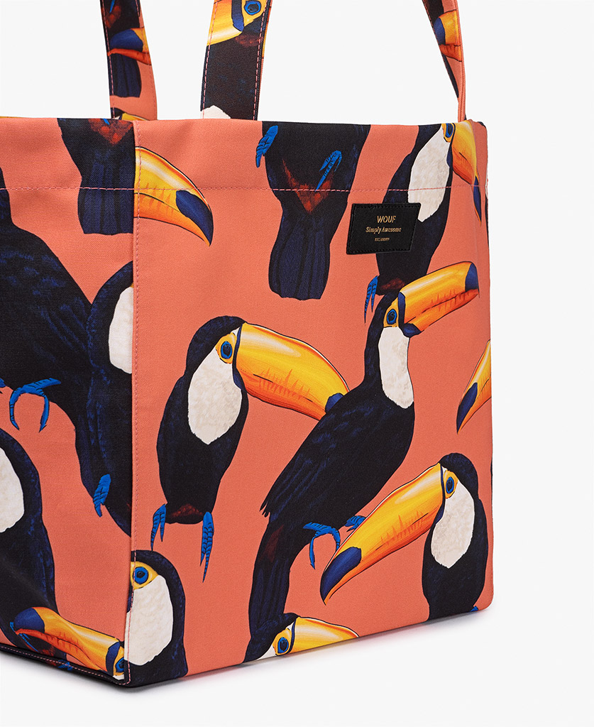 woman's coral big bag with toucans