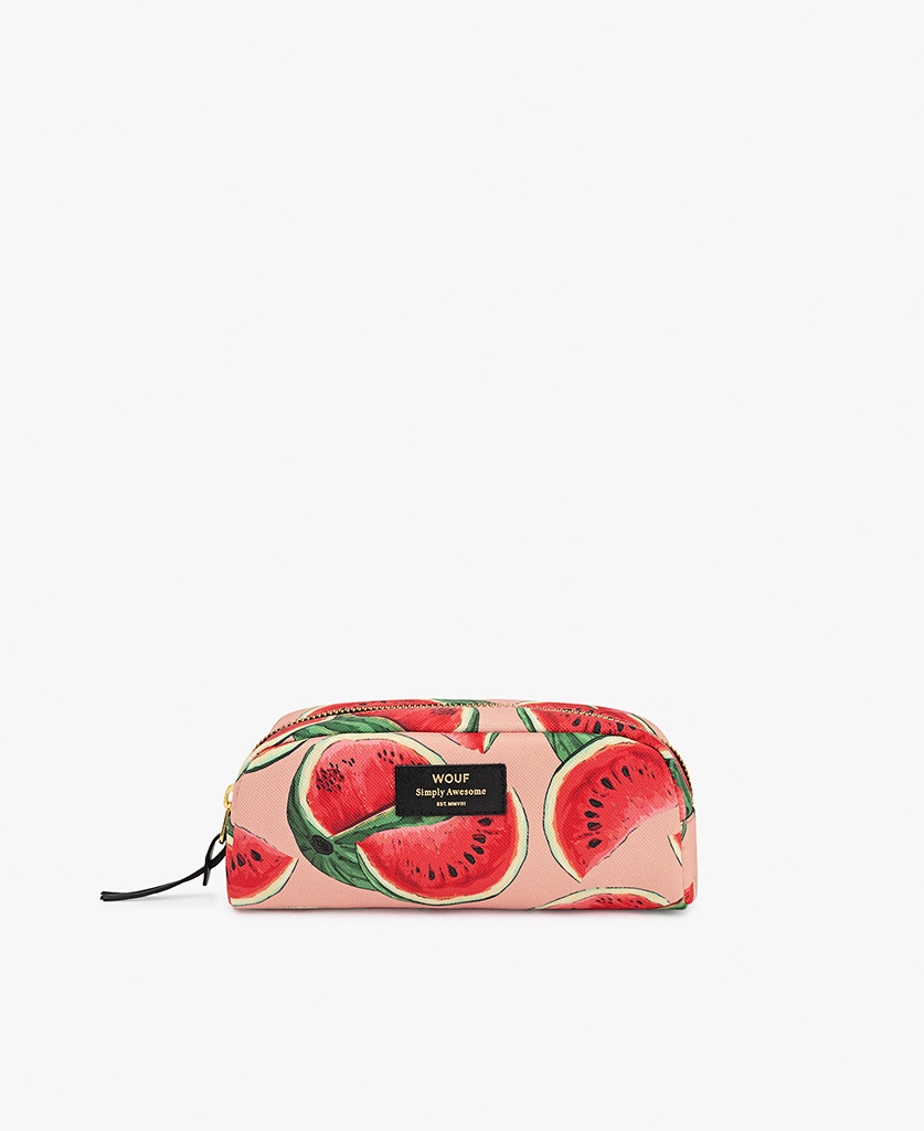 woman's small toiletry bag in pink with fruits