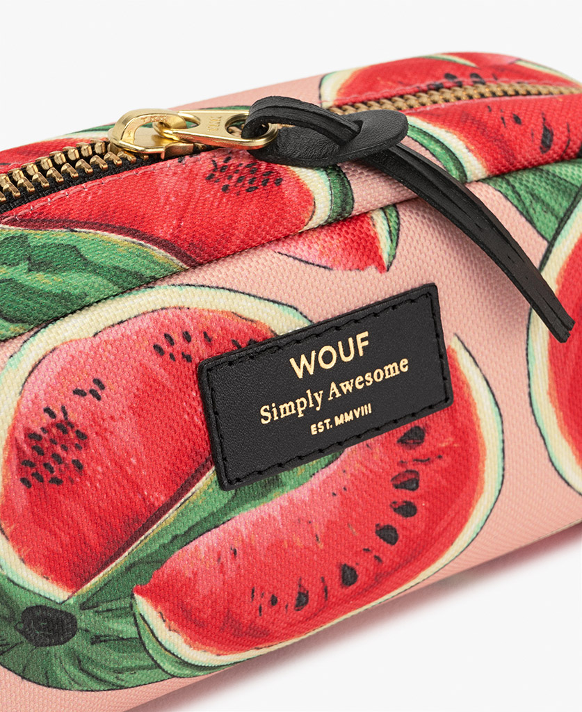 woman's toiletry bag in pink with fruits
