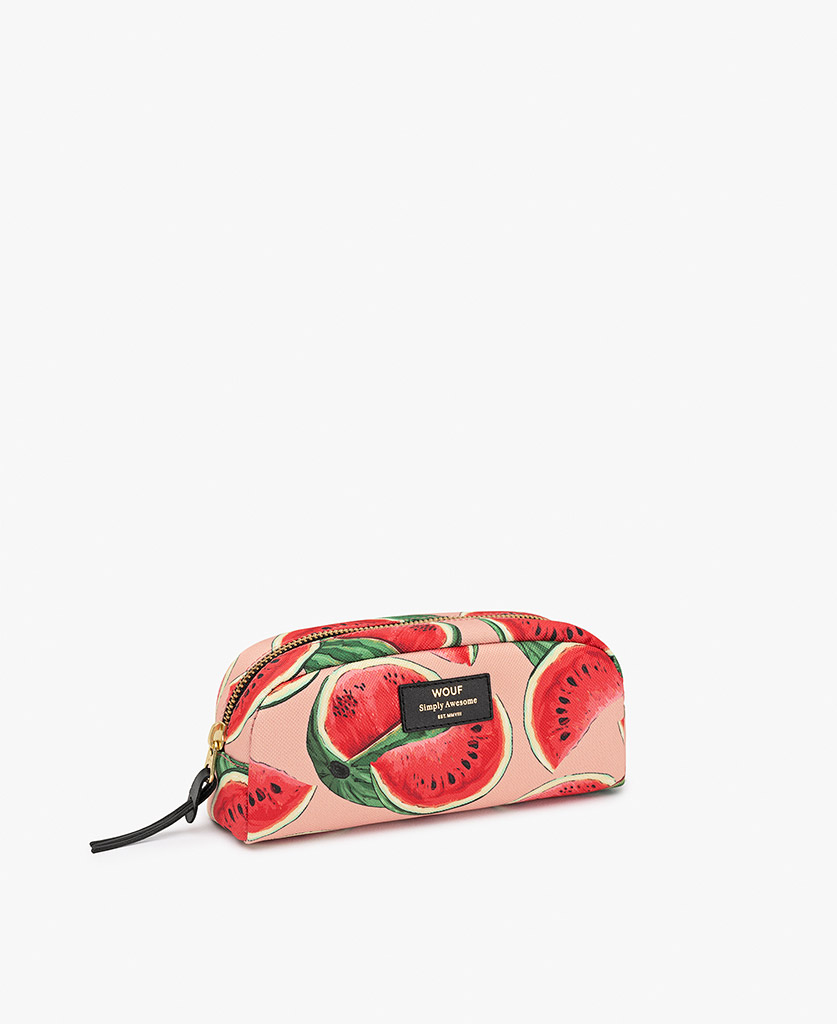 woman's pink toiletry bag