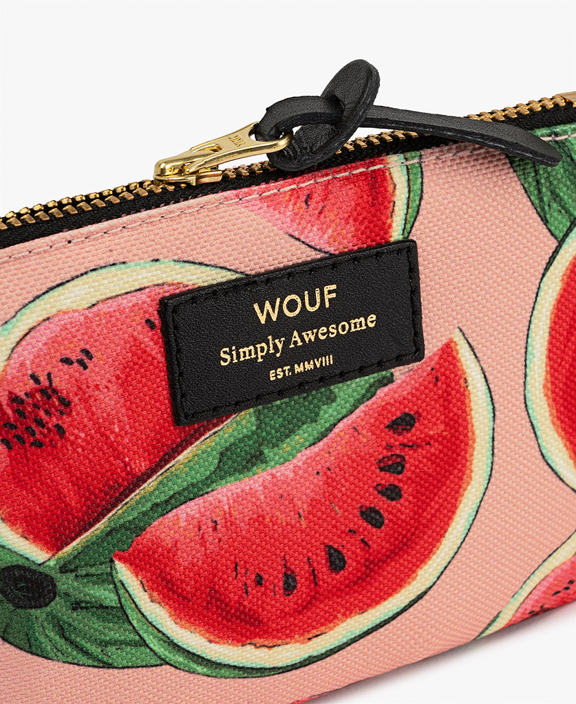 woman's pink pouch bag with fruits