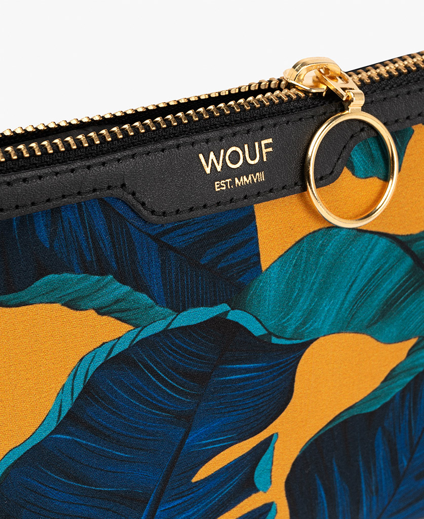 woman's yellow satin clutch with blue leaves