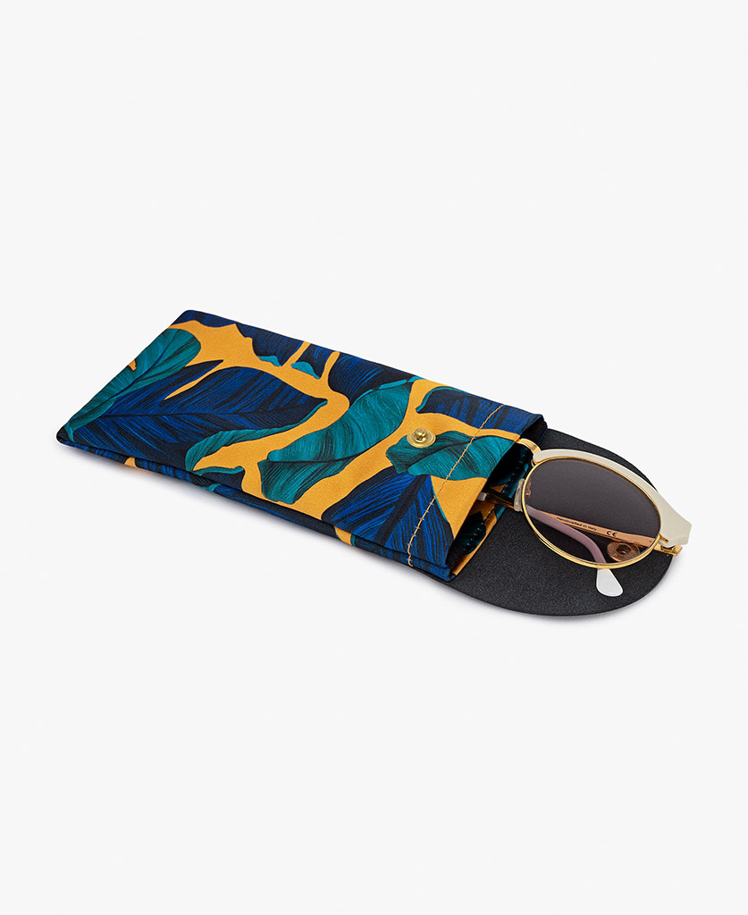 woman's mustard satin sunglass case with leather