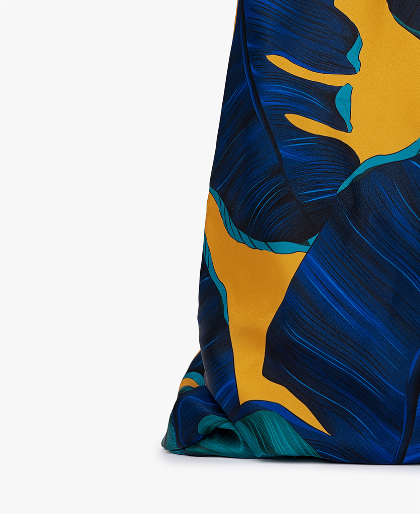 woman's satin bag in yellow and blue