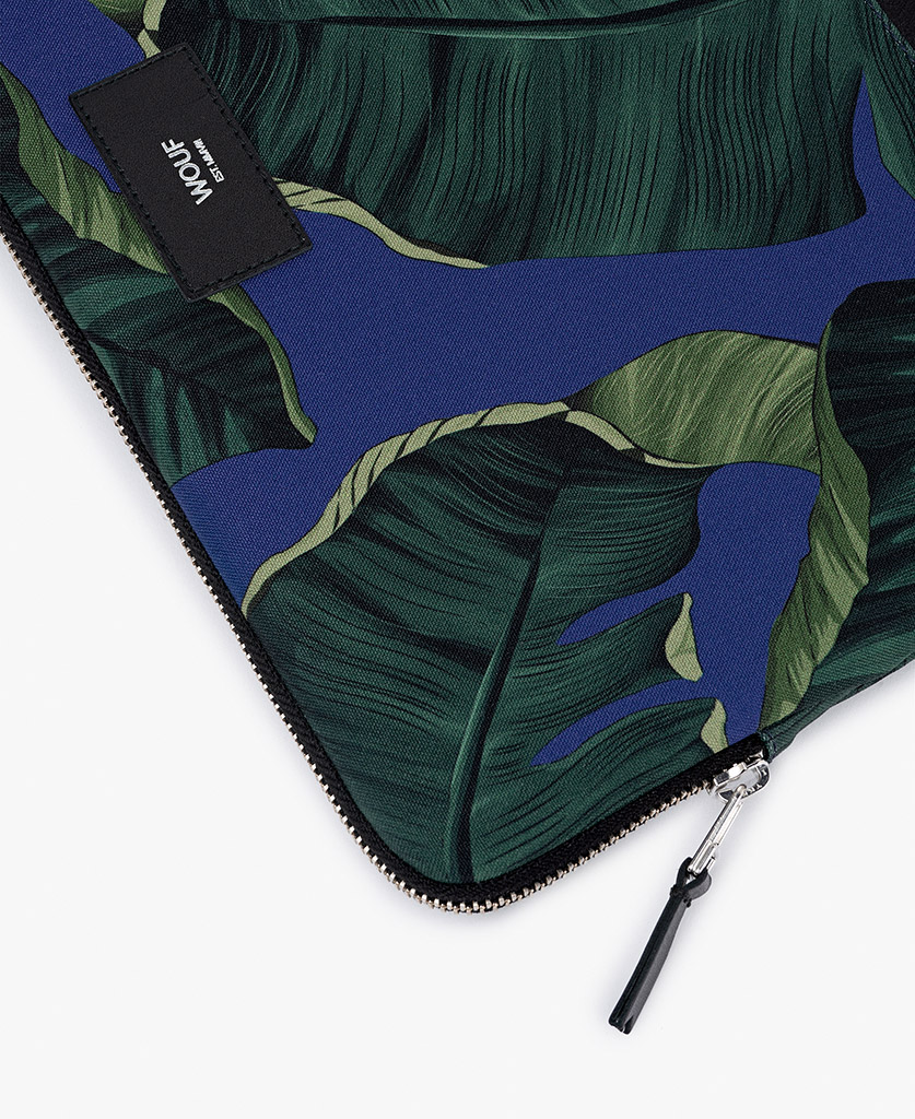 blue laptop cover for man with green leaves