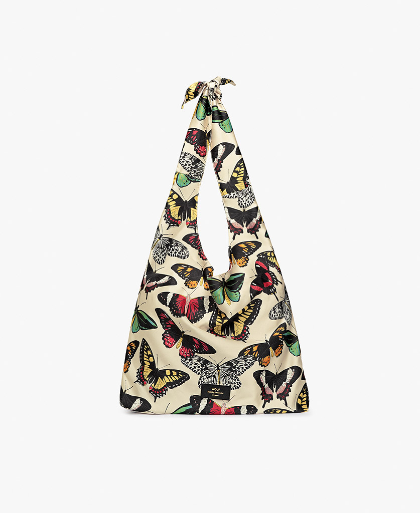 woman's beige satin bag with colorful butterflies
