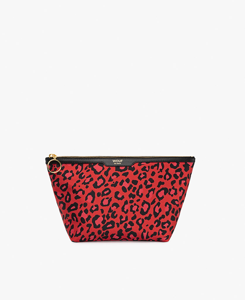 woman's red satin toiletry bag with leopard pattern