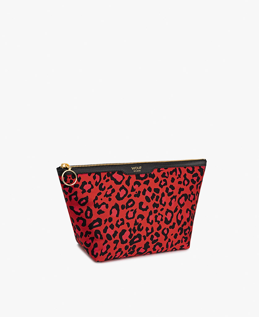 woman's red satin toiletry bag