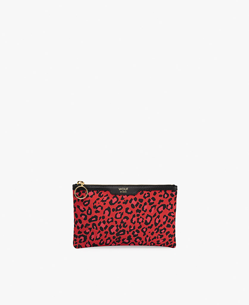 woman's red satin clutch with leopard pattern