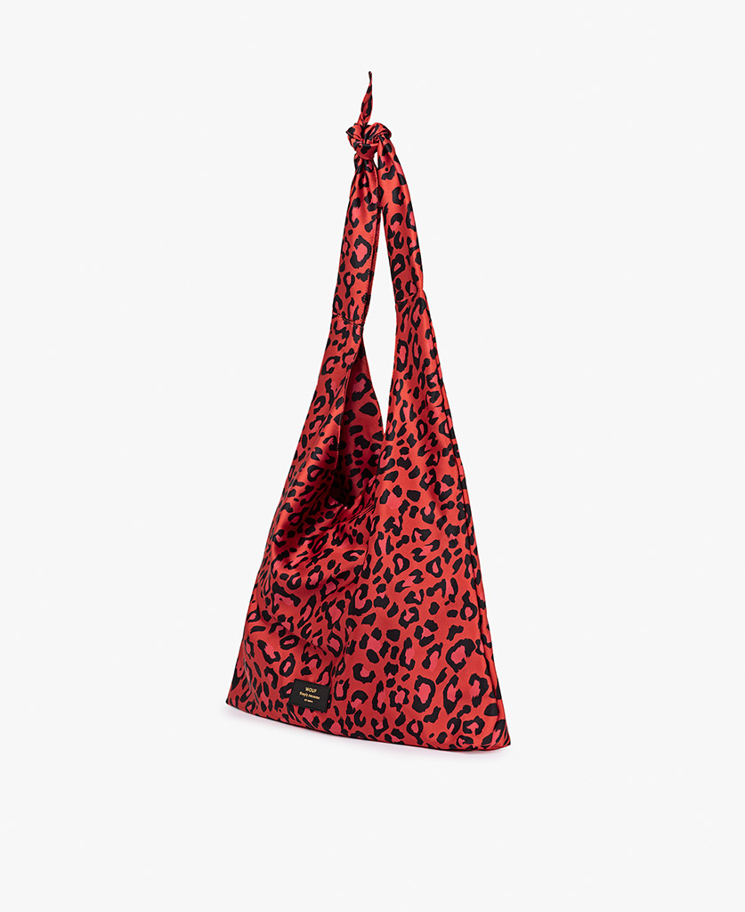 woman's red satin bag with leopard pattern