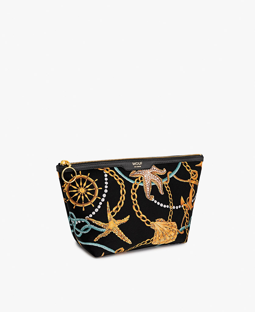 woman's satin toiletry bag with golden marine prints