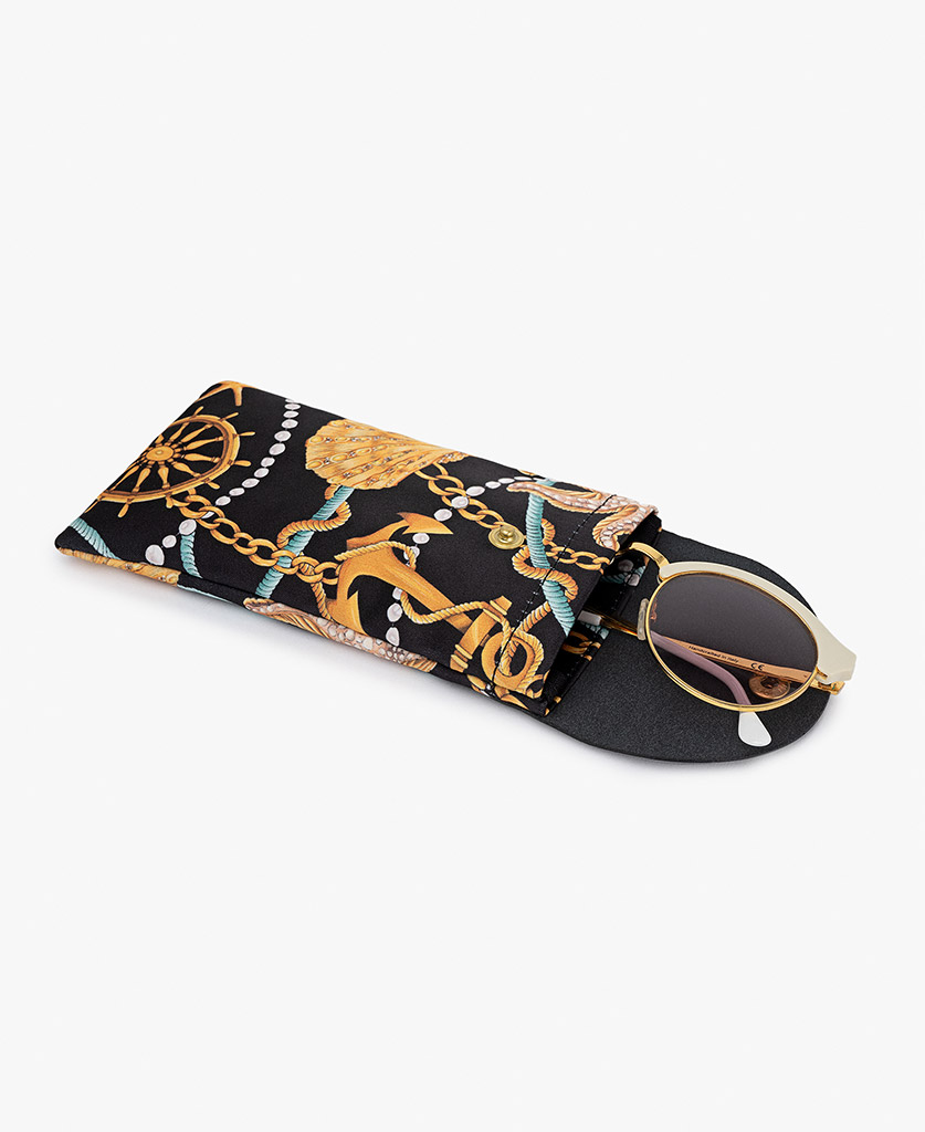 woman's satin sunglass case with leather with golden details